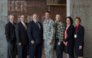 CIR Director Anthony Hassan (second from left) and Stephen Robinson (third from left), VP of External Veterans Affairs at Prudential, pose with other leaders of the University of Washington Tacoma conference, March 2014