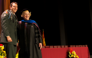 An MSW 2012 graduate with Dean Marilyn Flynn during the USC School of Social Work commencement ceremony.