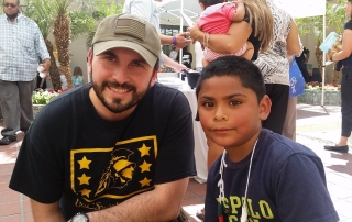 Kevin Benitez, MSW '15, during a Month of the Military Child event at the Los Angeles Public Library.