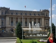Sara Kintzle, research assistant professor, in front of the Palace of the National Military Circle in Bucharest, Romania.